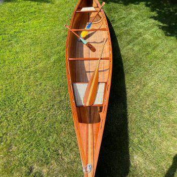 Blue and white canoe